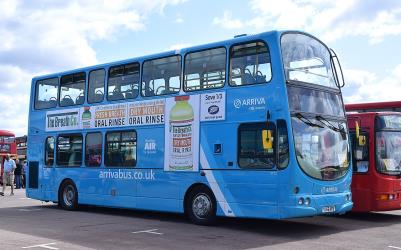 Double decker bus in blue corporate livery