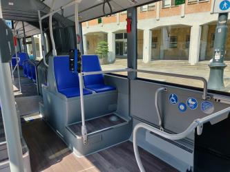 Bus interior showing space for disabled people